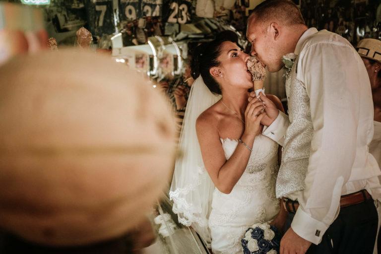 Bride and groom eating ice cream during wedding at Sorrento wedding venue Villa Antiche Mura, Amalfi Coast in Italy
