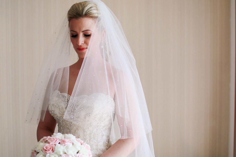 bride getting ready wearing Sophia Tolli wedding dress bridal preparations, wedding photography at Liberty Hotels Lykia
