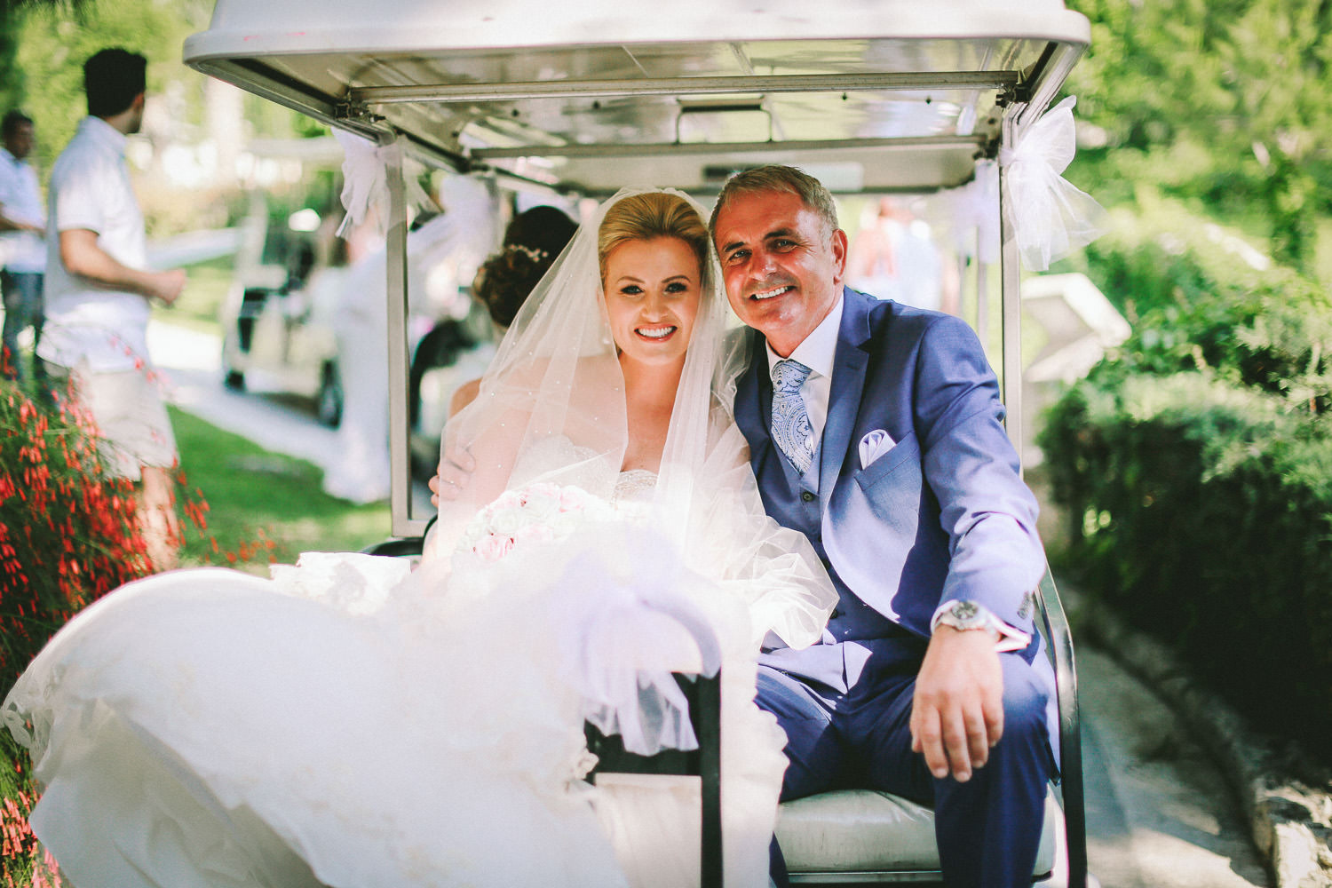 bride and father on golf kart wedding photography at Liberty Hotels Lykia