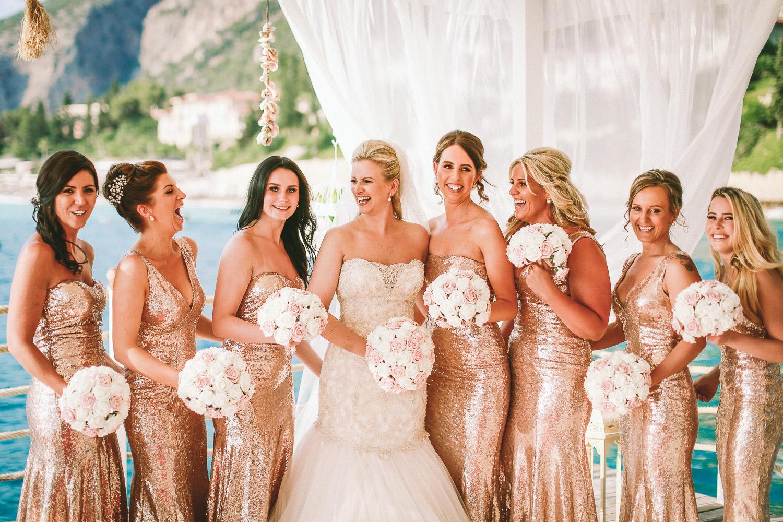 bride and bridesmaids laughing wedding photography at Liberty Hotels Lykia