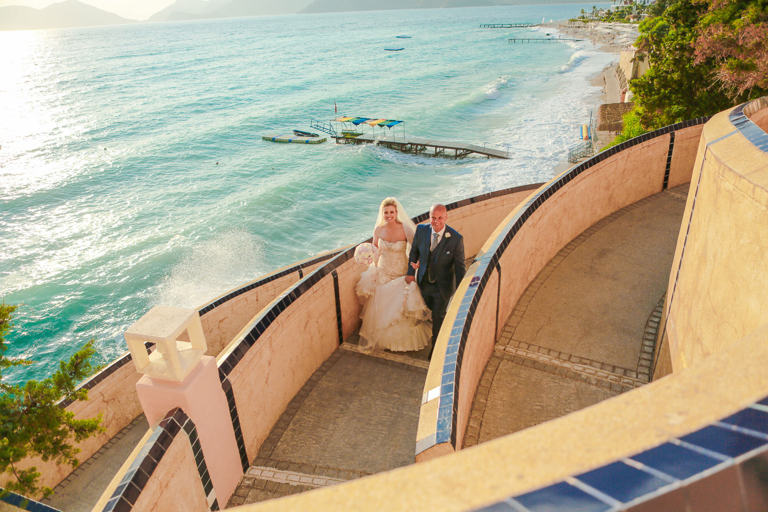 bride and groom walking up steps at Liberty Hotels Lykia