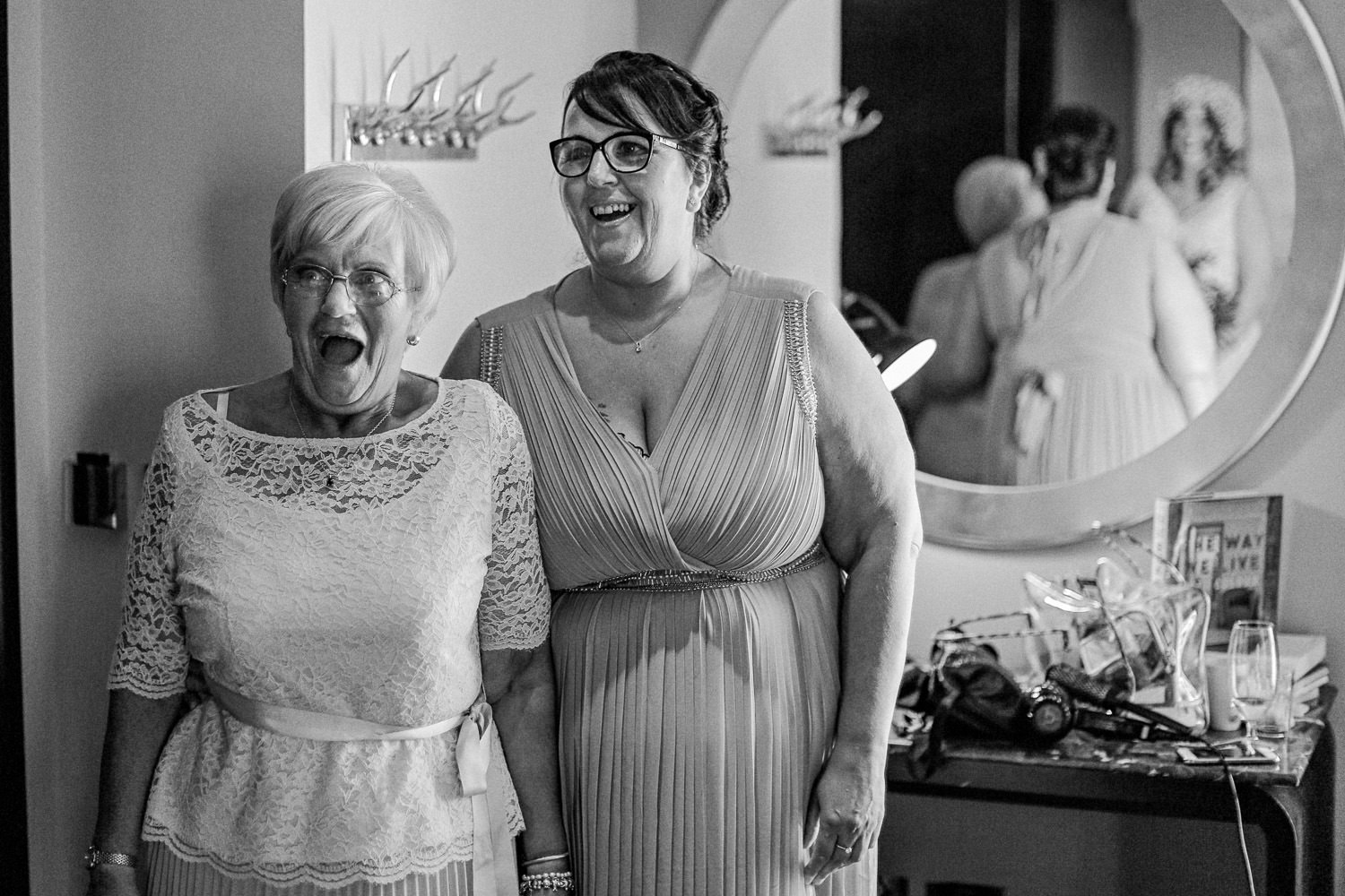 Shocked happy reactions from mother of bride Wedding reception Rustic wedding at Meols Hall Southport