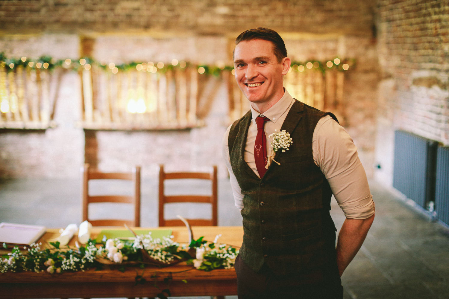 groom smiling as bride walks in Wedding reception Rustic wedding at Meols Hall Southport