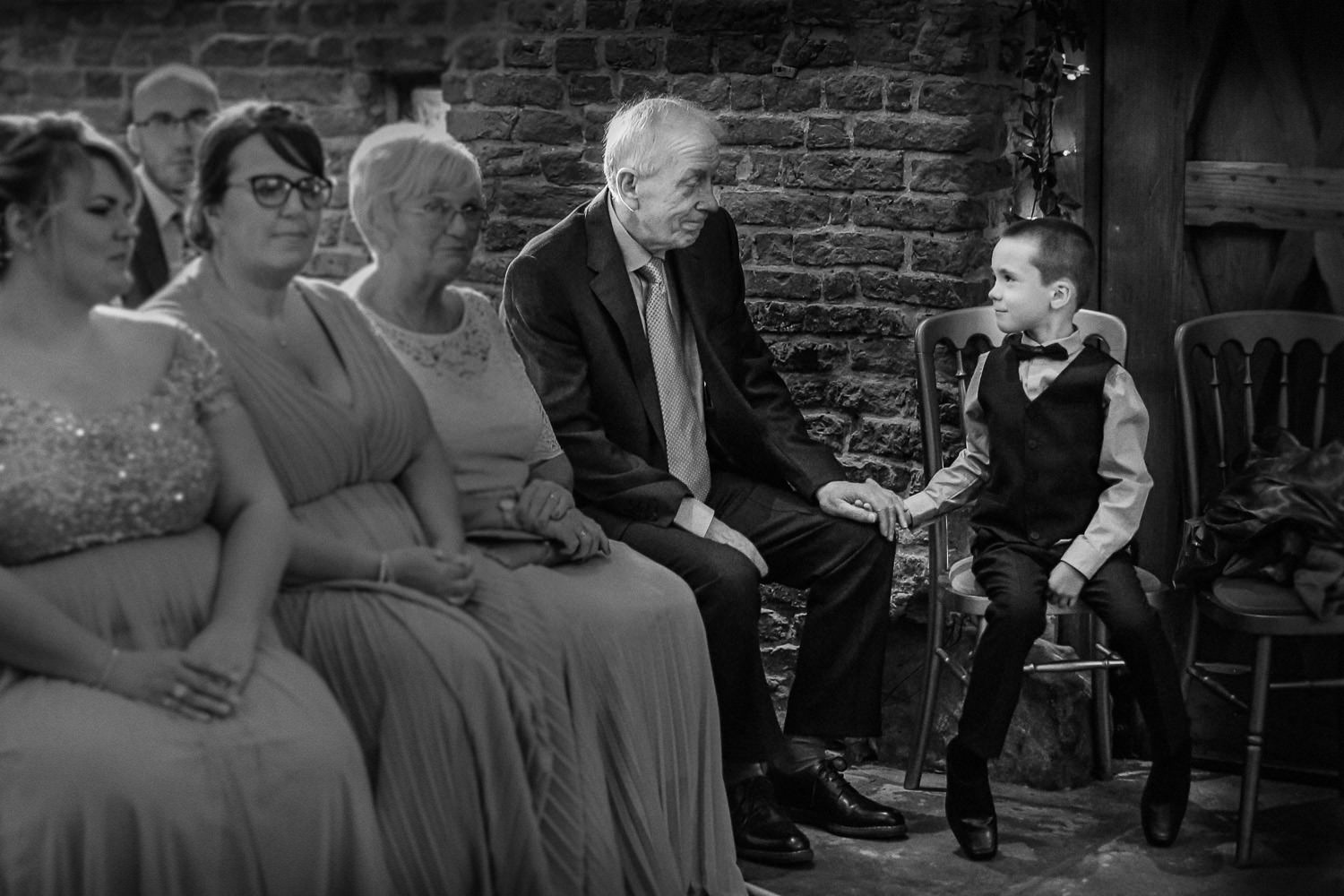 Wedding reception Rustic wedding at Meols Hall Southport. Little boy holding granddads hand