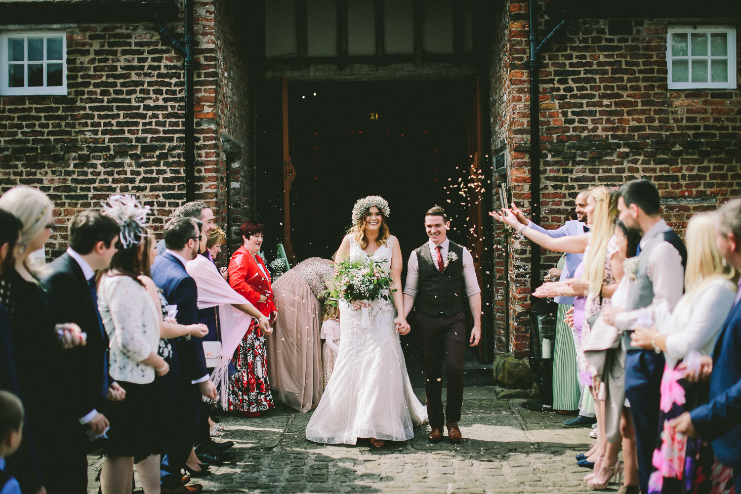 Confetti shot of bride and groom Rustic wedding at Meols Hall Southport