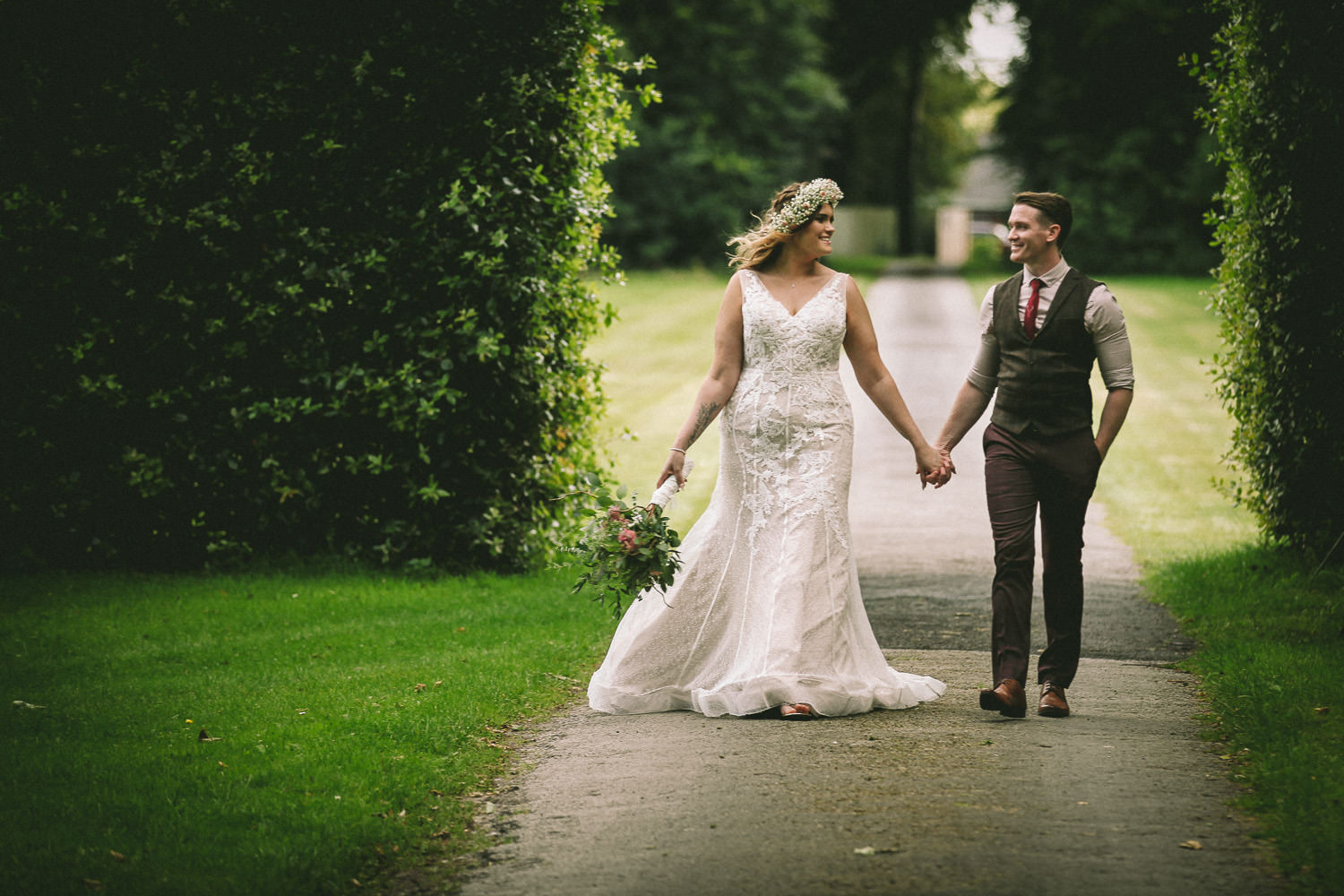 Bride and groom walking holding hands Rustic wedding at Meols Hall Southport