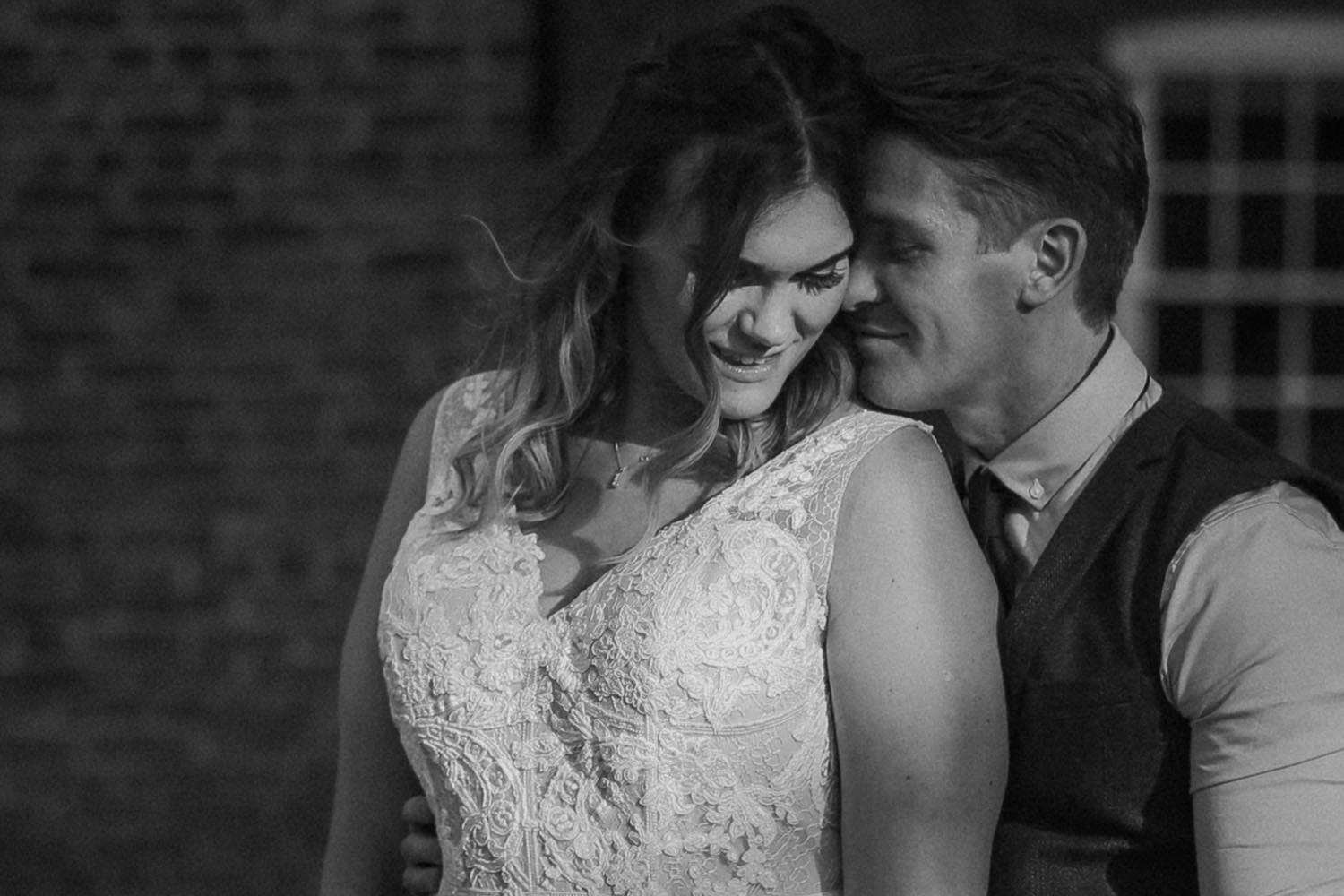 Black and white close up of bride and groom faces Rustic wedding at Meols Hall Southport