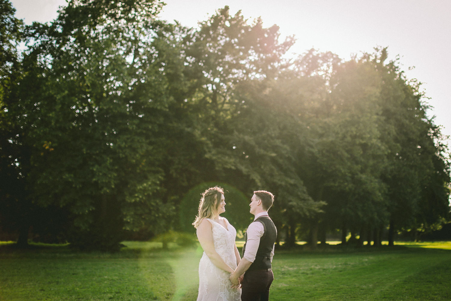 bride and groom in grounds Rustic wedding at Meols Hall Southport
