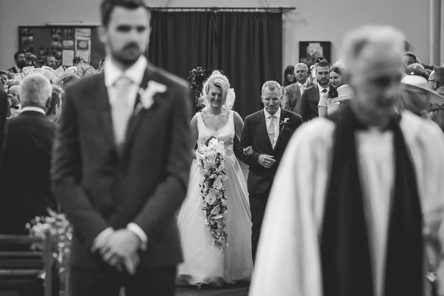 Bride walking down the aisle St Thomas Church Rhyl