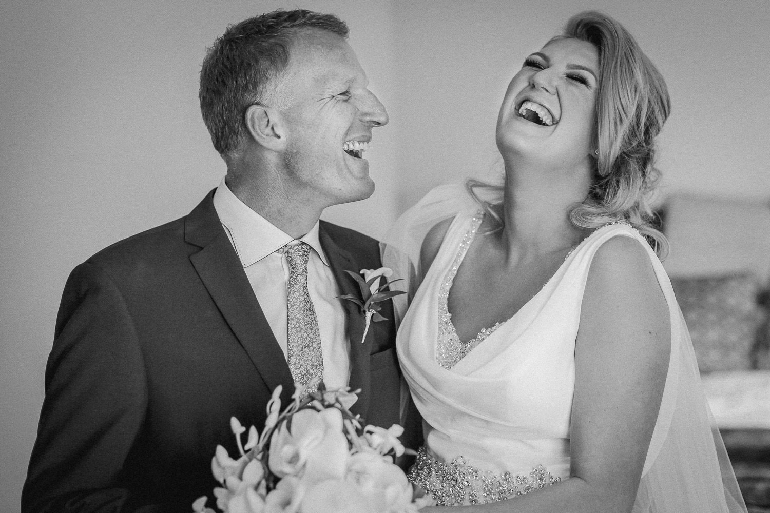 Black and white photo of father and bride laughing during Wedding preparations at The Kinmel Hotel