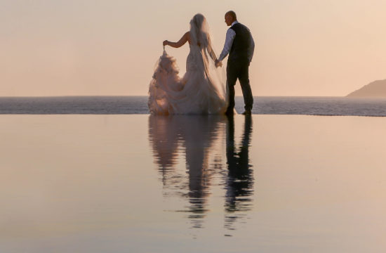 Bride and groom infinity pool reflection at sunset wedding photography at Liberty Hotels Lykia