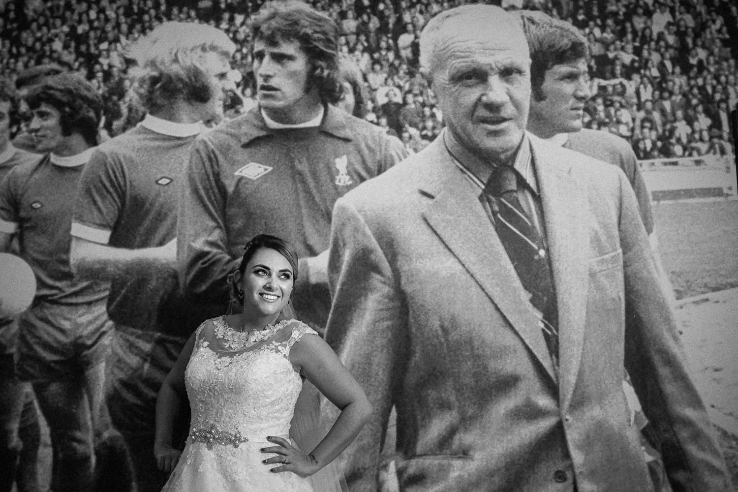 Bride with picture of Bill Shankly at Shankly Hotel Top 10 wedding venues in Liverpool