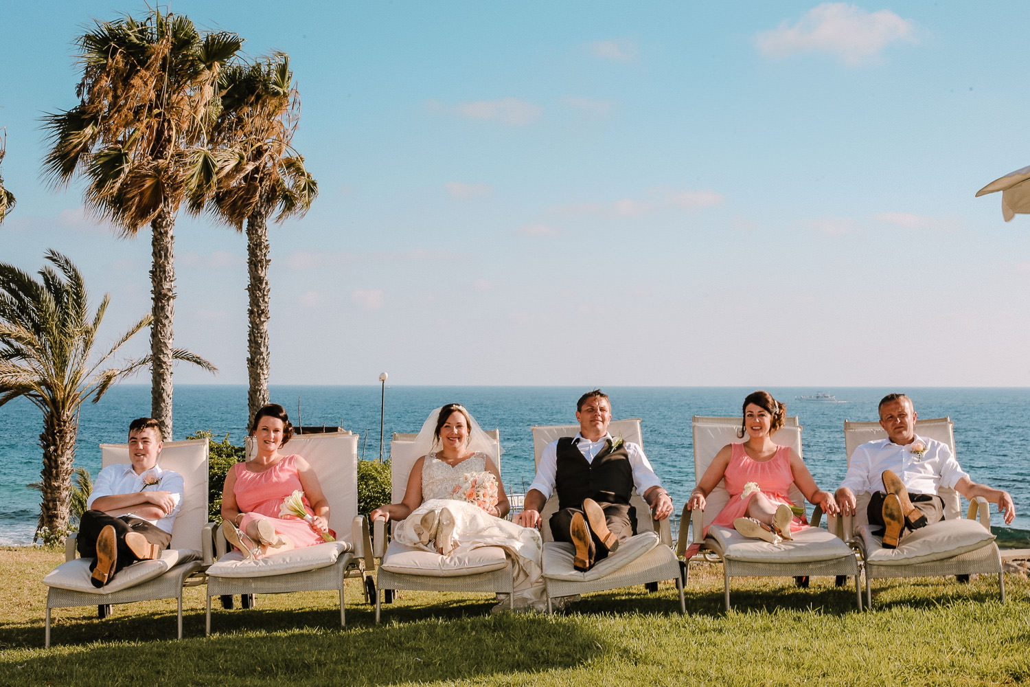 bridal party sitting on sun loungers alexander the great hotel paphos