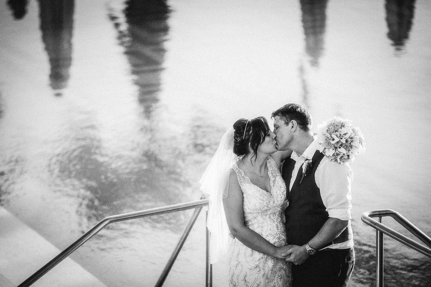 black and white photo bride and groom kissing Alexander the great hotel wedding paphos