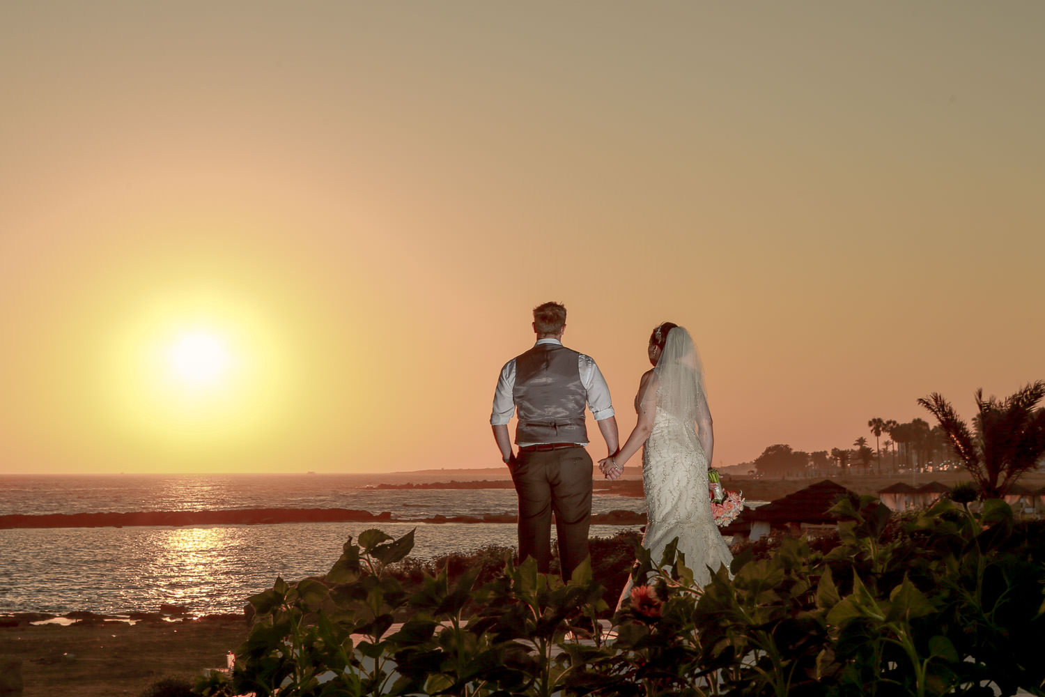 Bride and groom watching Paphos sunset