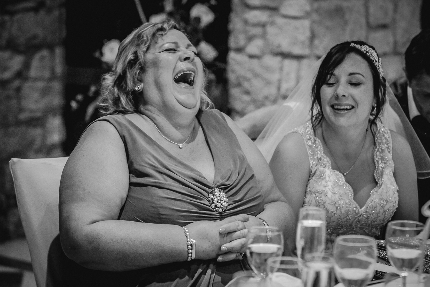 woman laughing at wedding speeches Alexander the great hotel Paphos wedding photography