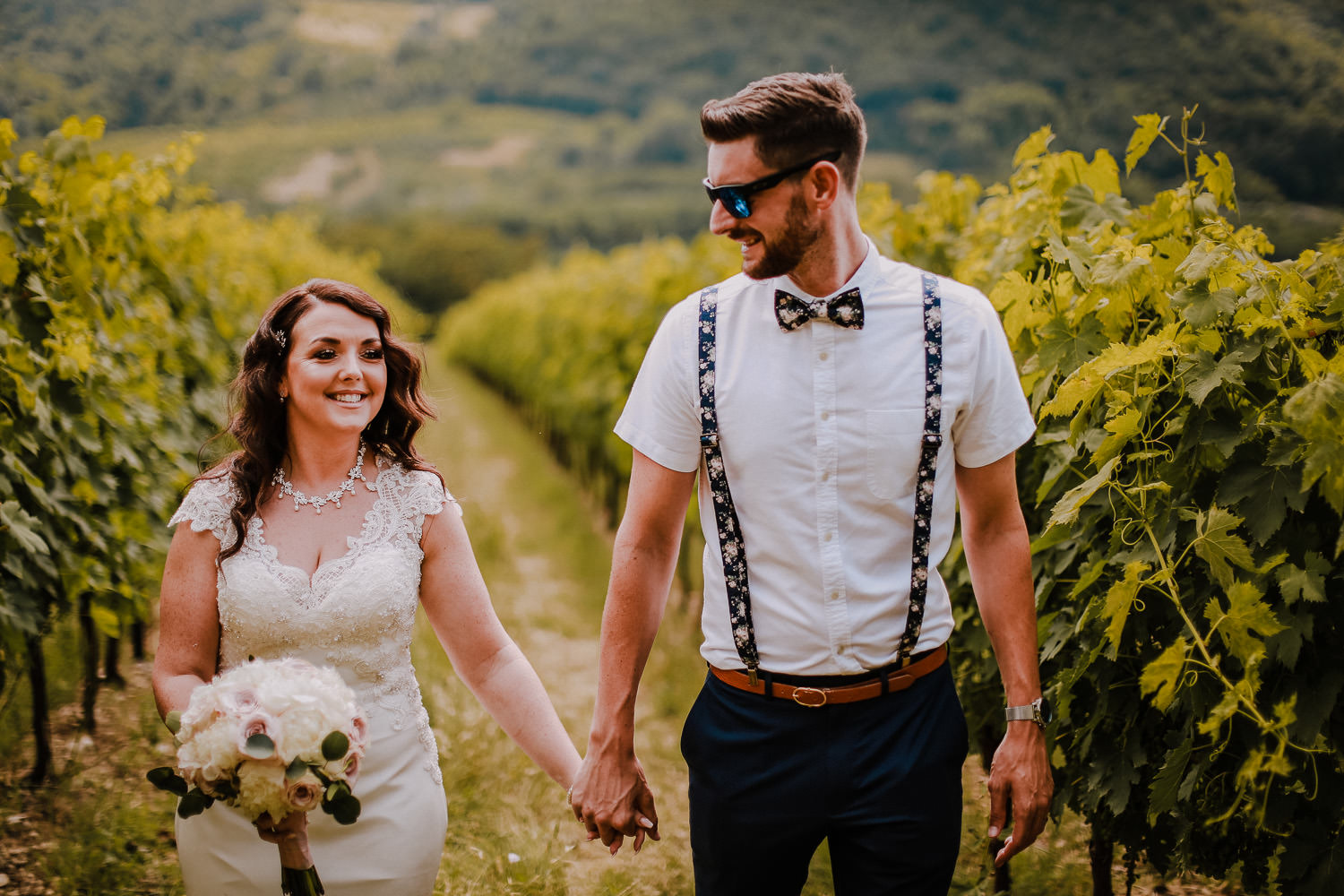 Bride and groom in vine yard fields wedding in Tuscany