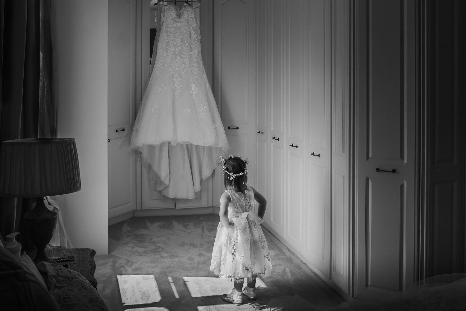 Little girl looking at Morilee wedding gown