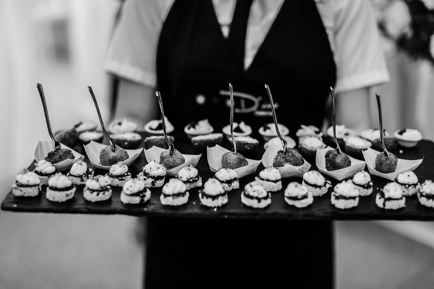 Food Black and white photo of bride and groom family farm marquee wedding Ormskirk Lancashire Photographer