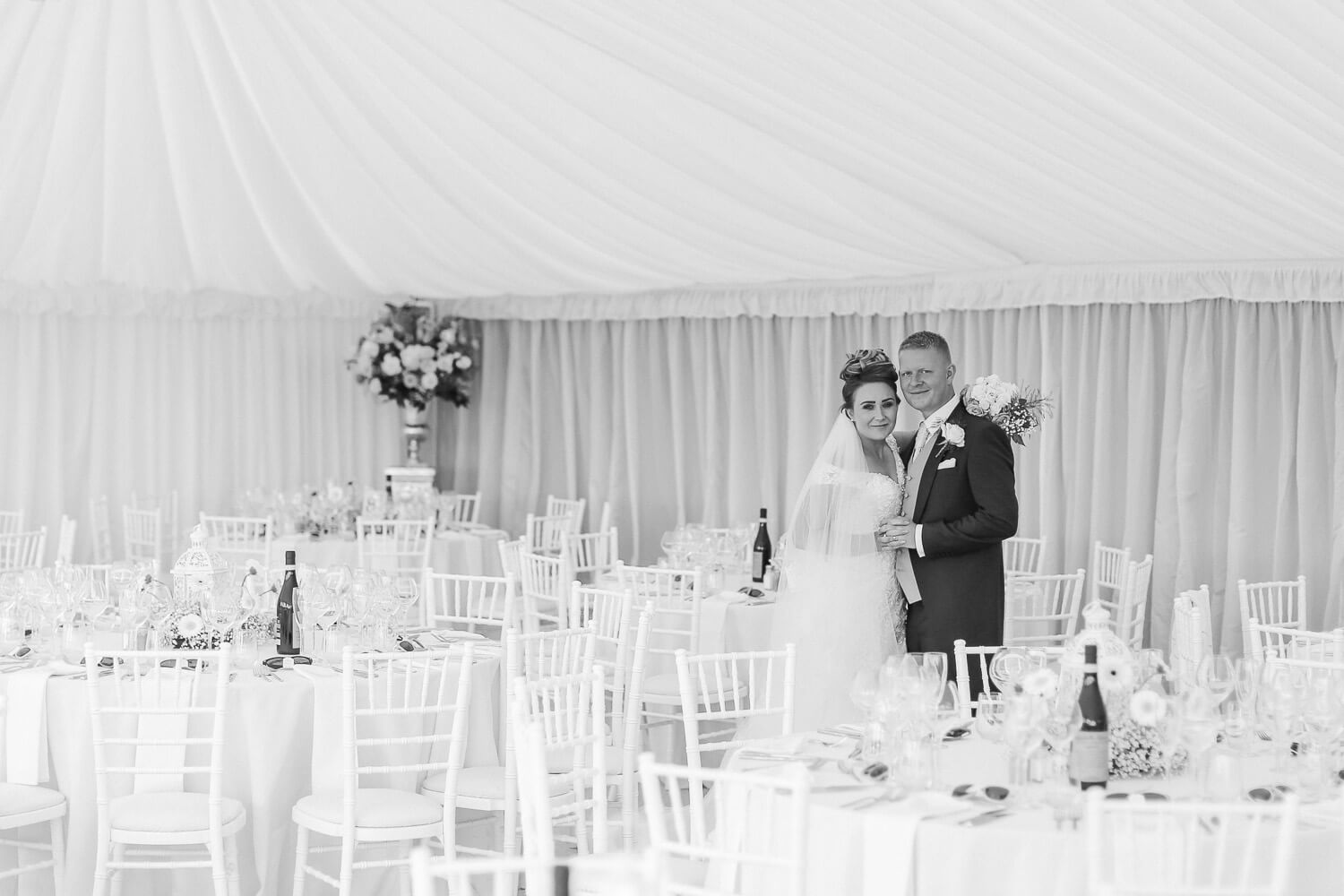 Black and white photo of bride and groom family farmhouse marquee wedding Ormskirk Lancashire Photographer