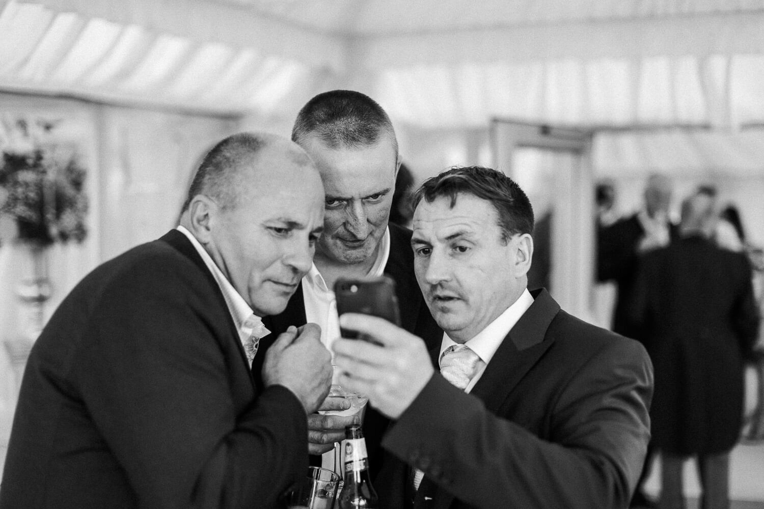 nature pictures Guests at wedding reception family farm marquee wedding Ormskirk Lancashire Photographer