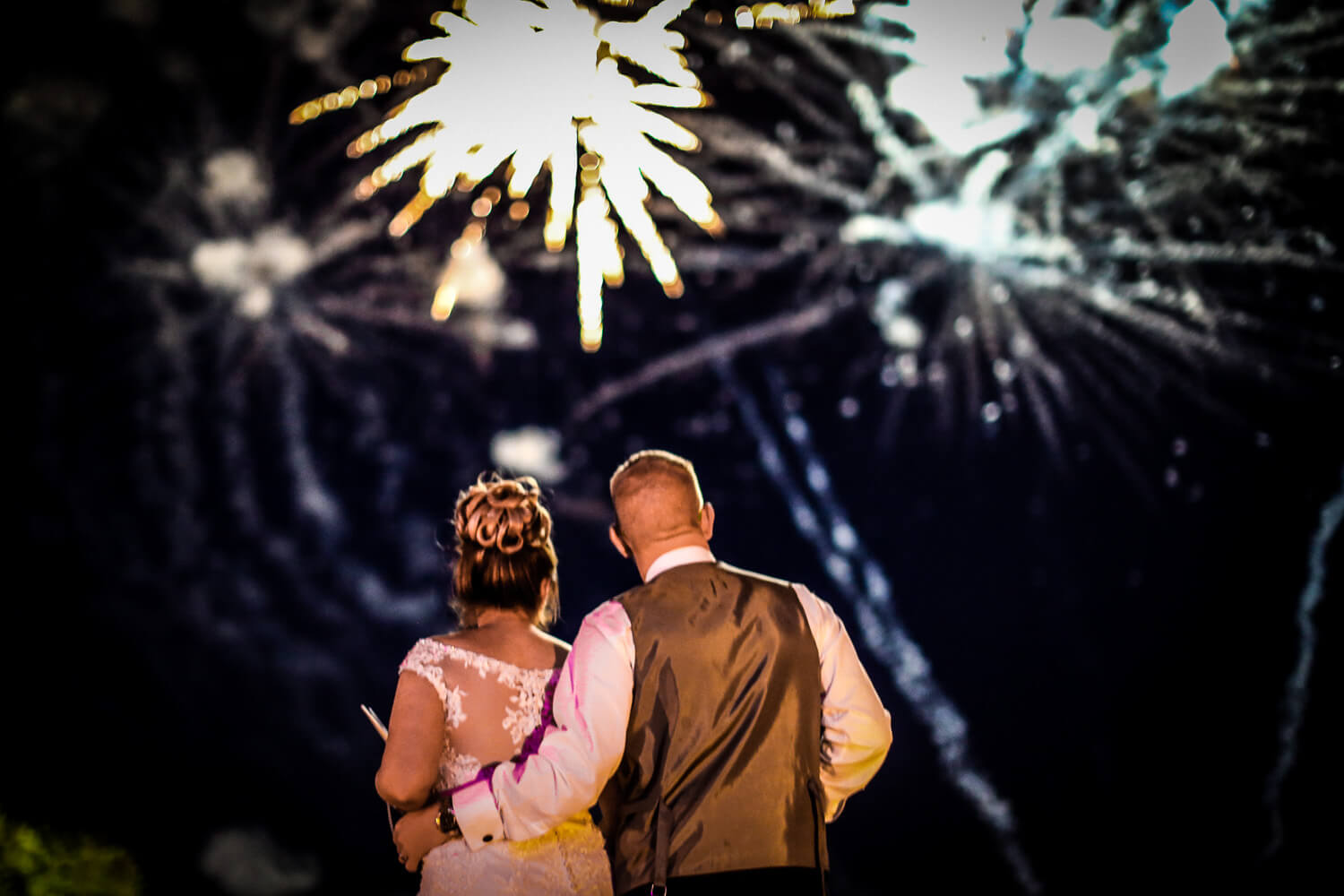 Bride and groom watching fireworks wedding guests dancing family farm marquee wedding Ormskirk Lancashire Photographer