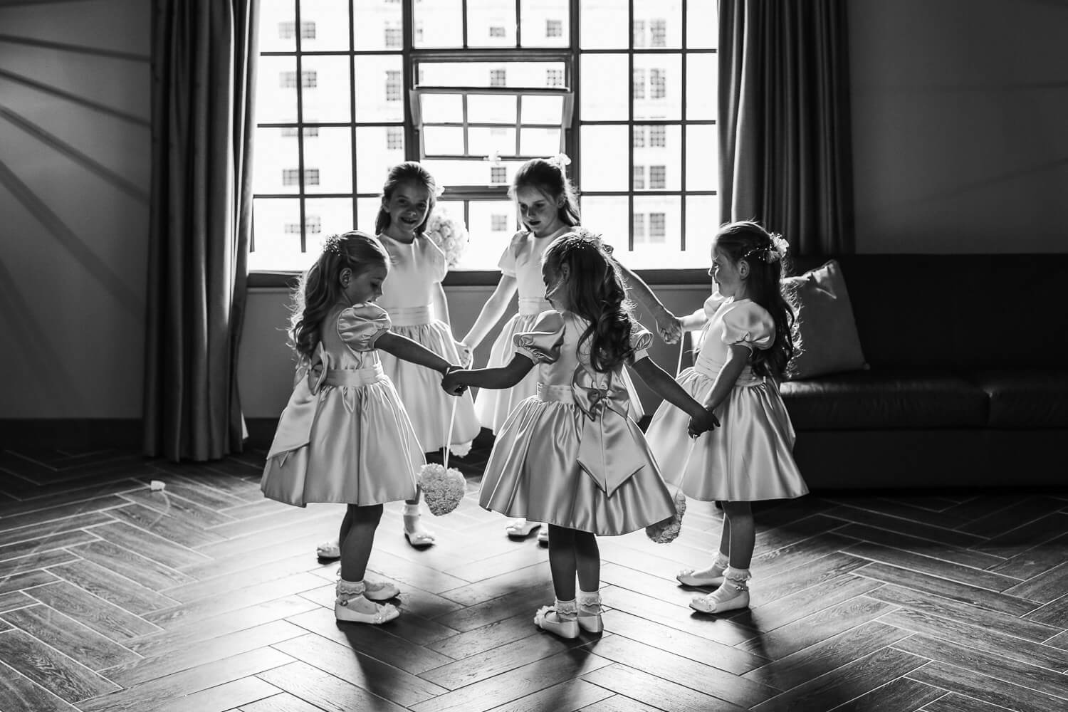 Flower girls holding hands Titanic Hotel Wedding Liverpool.