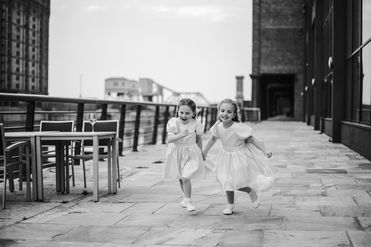 flower girls running Titanic Hotel Wedding Liverpool.