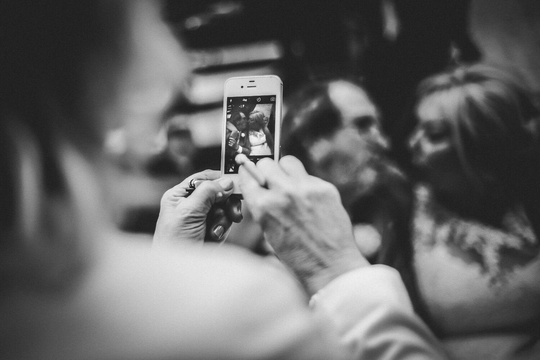 Titanic Hotel Wedding Liverpool. Guest photo on phone