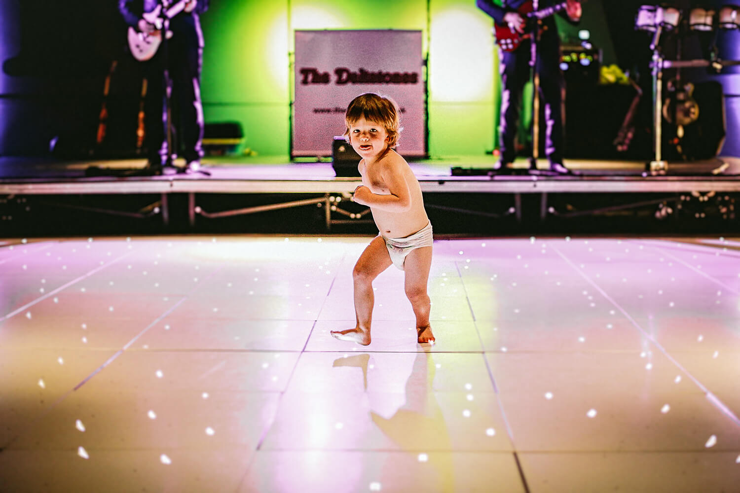 Titanic Hotel Wedding Liverpool. Little boy dancing wearing nappy