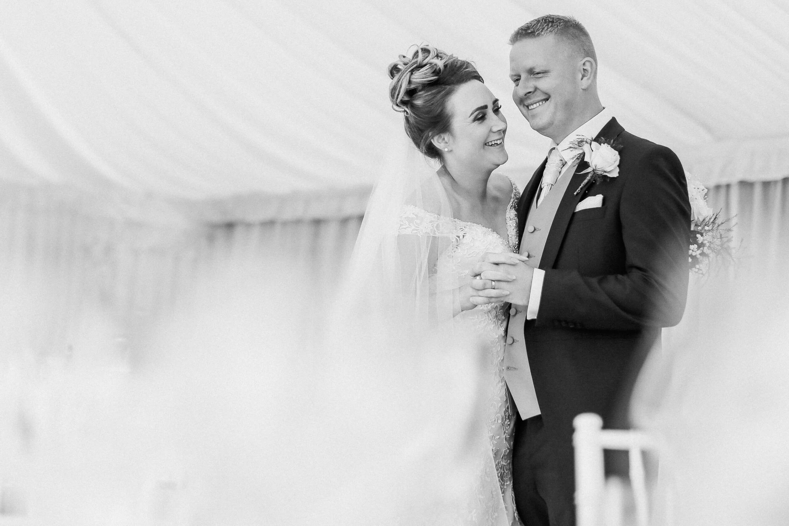 marquee farmhouse wedding Lancashire. Black and white natural photo of bride and groom Family farm Lancashire marquee wedding photography