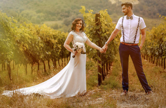 Bride and groom in vine year Tuscany wedding photographer Castello di bibbione