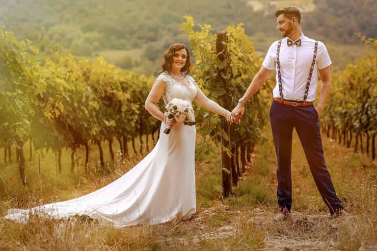 Bride and groom in vine year Tuscany wedding photographer Castello di bibbione