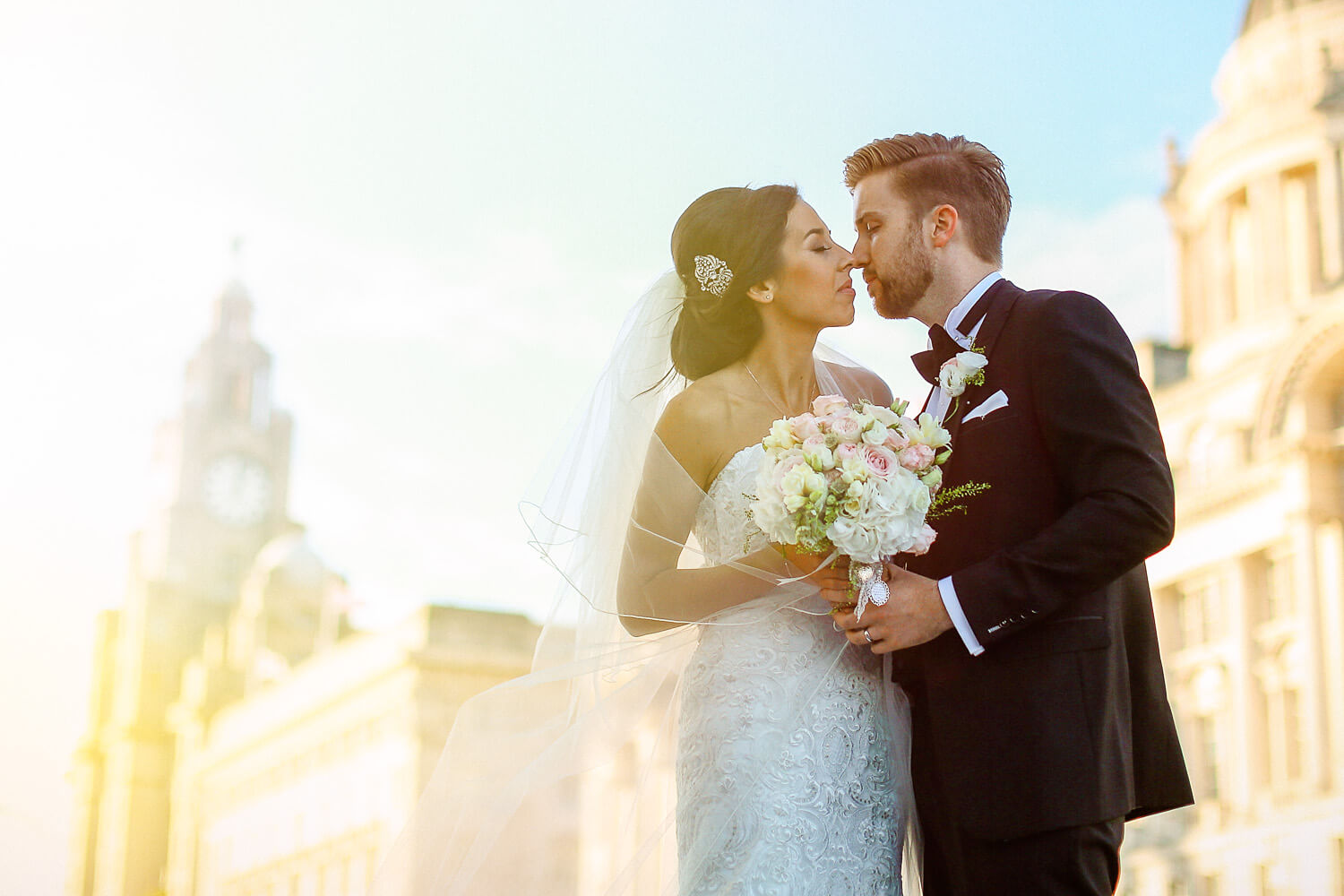 Cool portrait of bride and groom in front of Liver Building 30 James Street Liverpool wedding photography