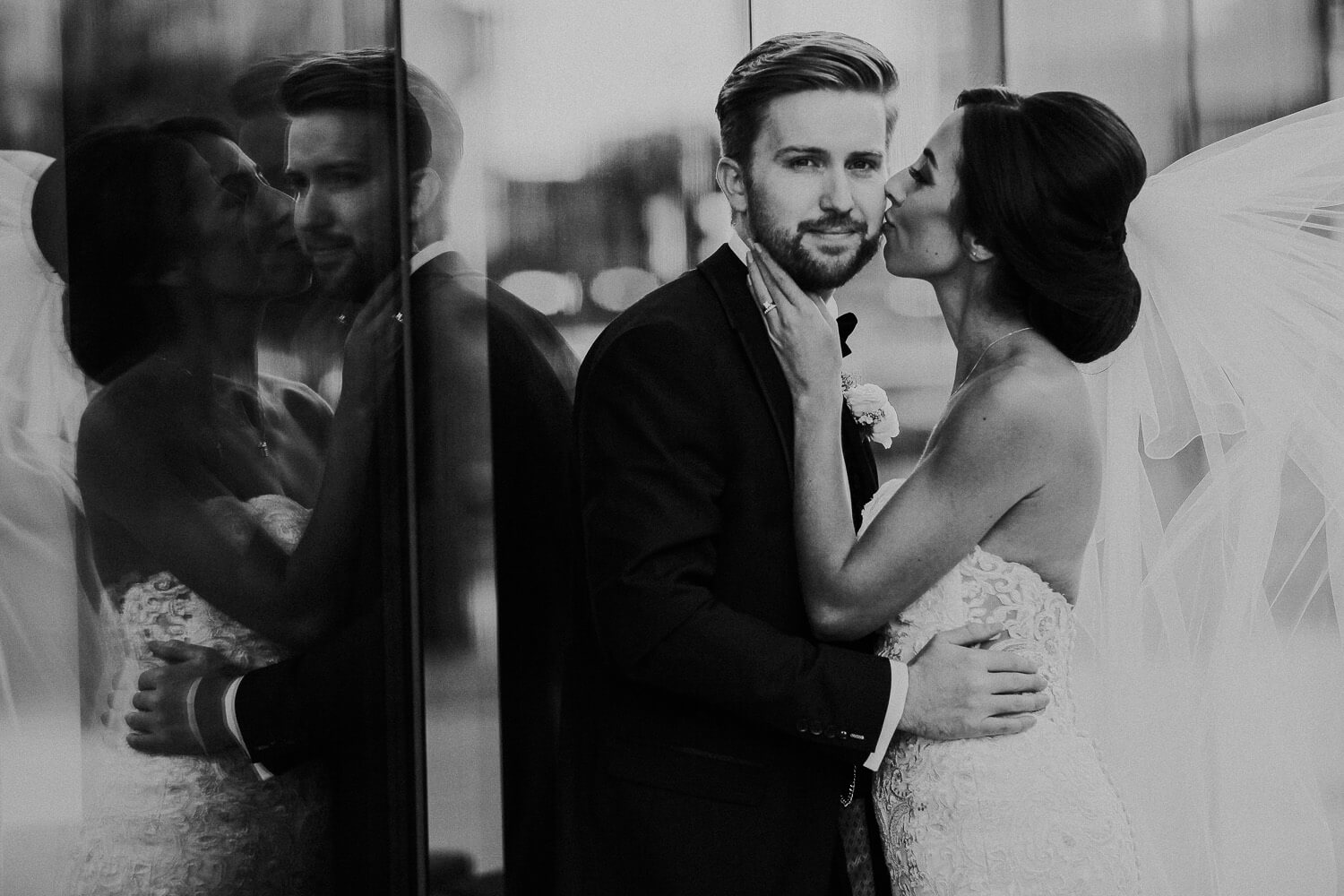 Cool black and white portrait of bride kissing groom in tuxedo 30 James Street Liverpool wedding photography