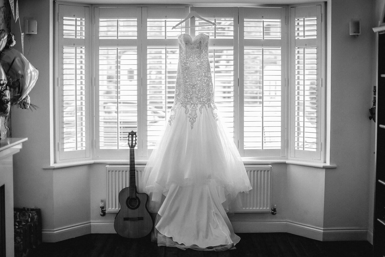 Morilee wedding dress having in window with dad's guitar 30 James Street Liverpool wedding photography