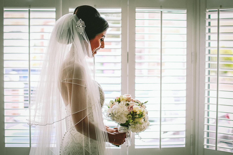 portrait of bride in window 30 James Street Liverpool wedding photography