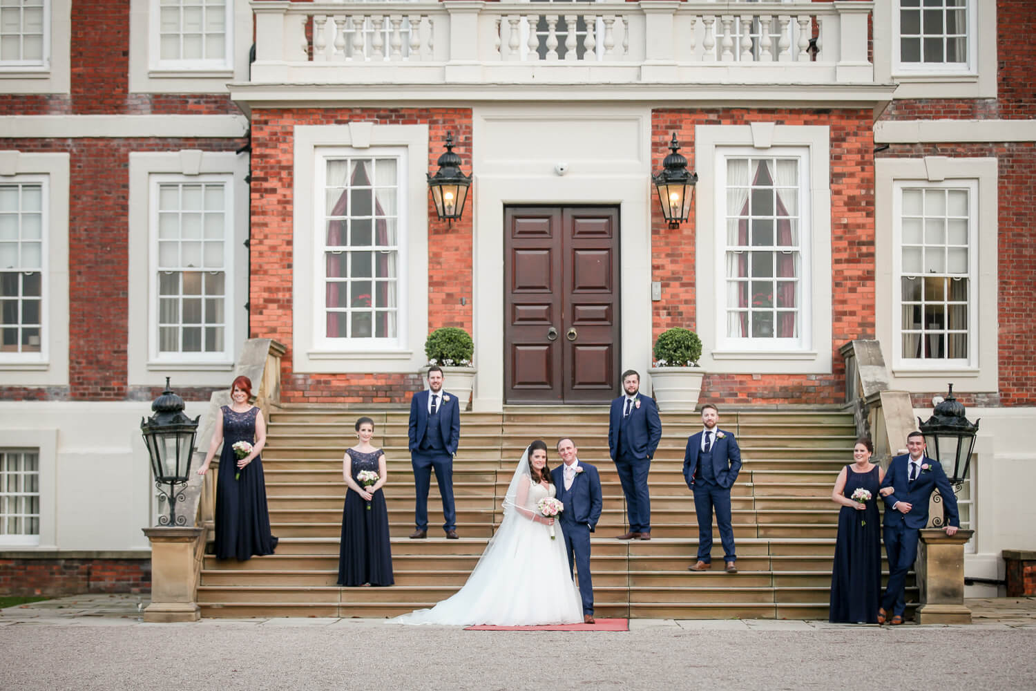 Knowsley Hall wedding photography bridal party on steps