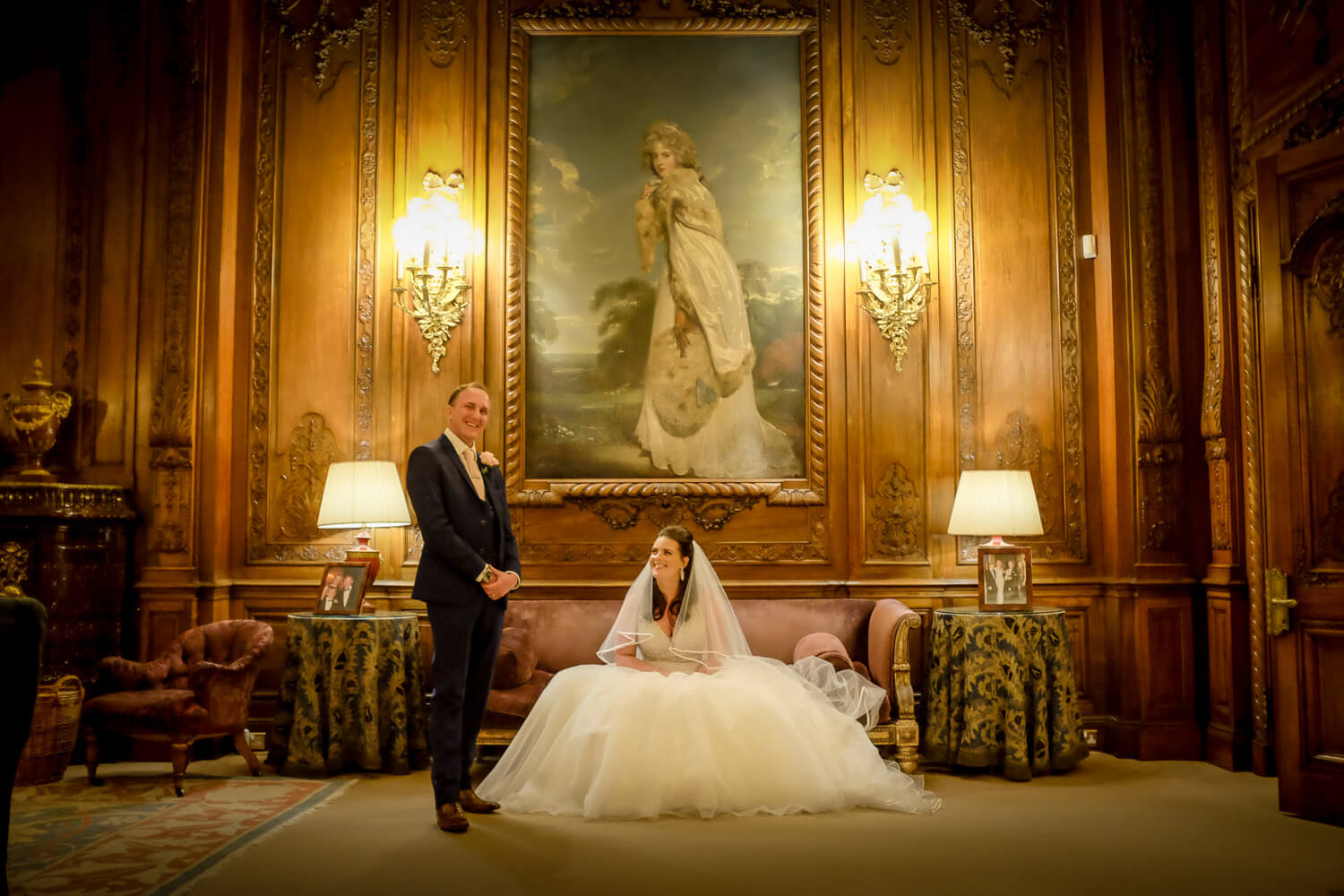 Knowsley Hall wedding photography bride and groom under large paining