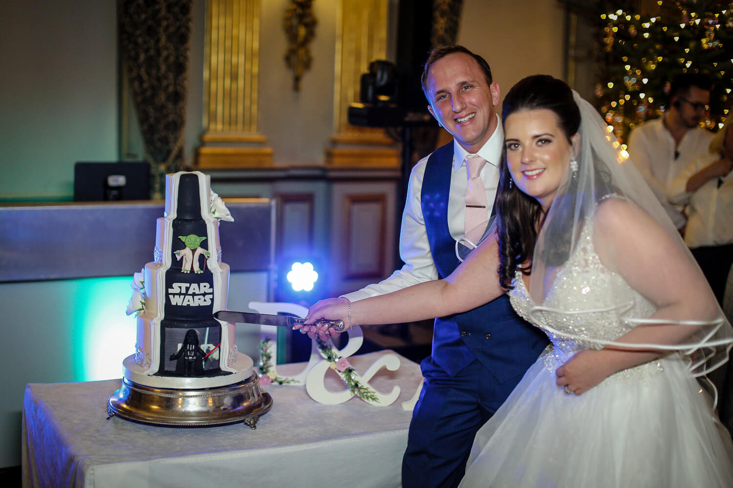 Knowsley Hall wedding photography bride and groom cutting Star Wars cake