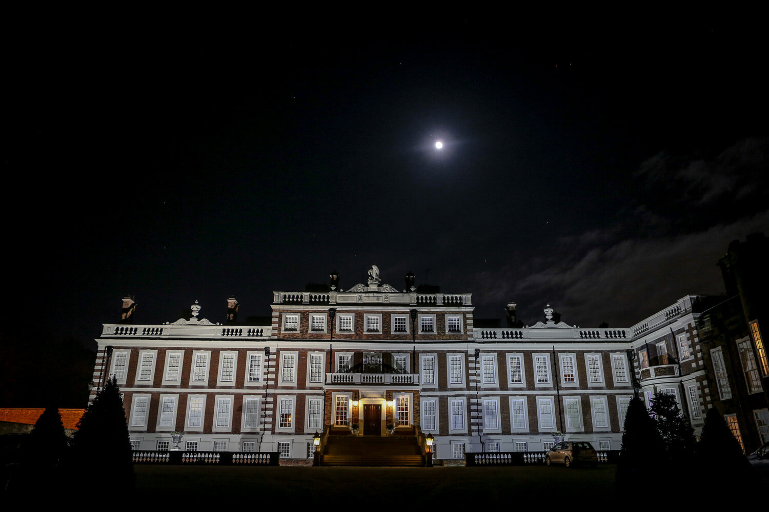Knowsley Hall at night under moonlight