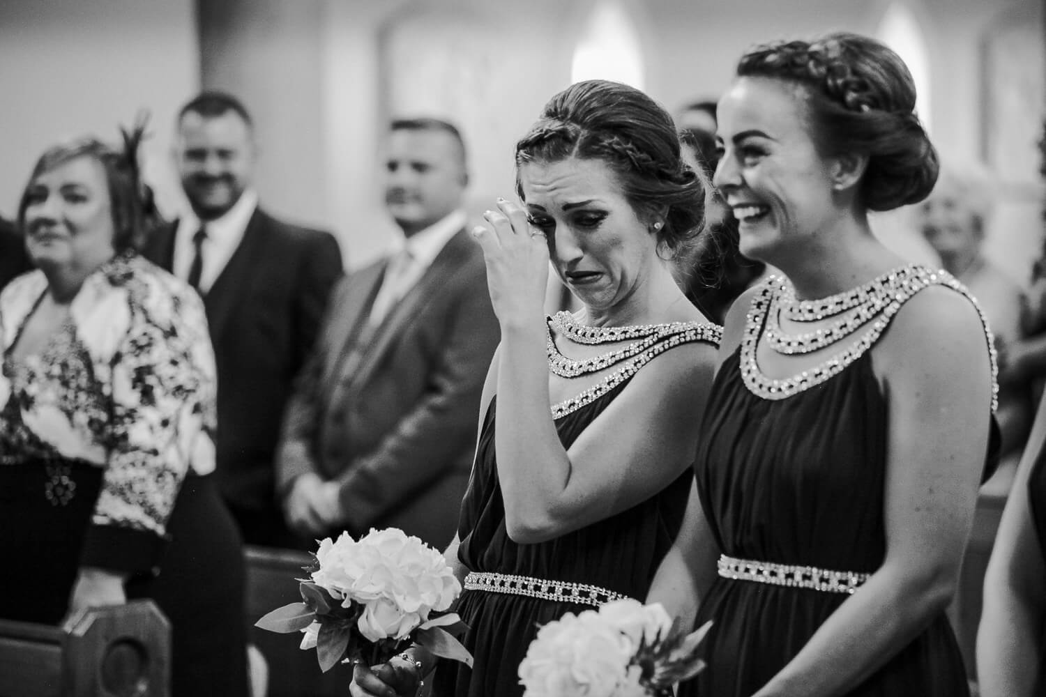 wedding at St Teresa's church Liverpool, bridesmaid crying