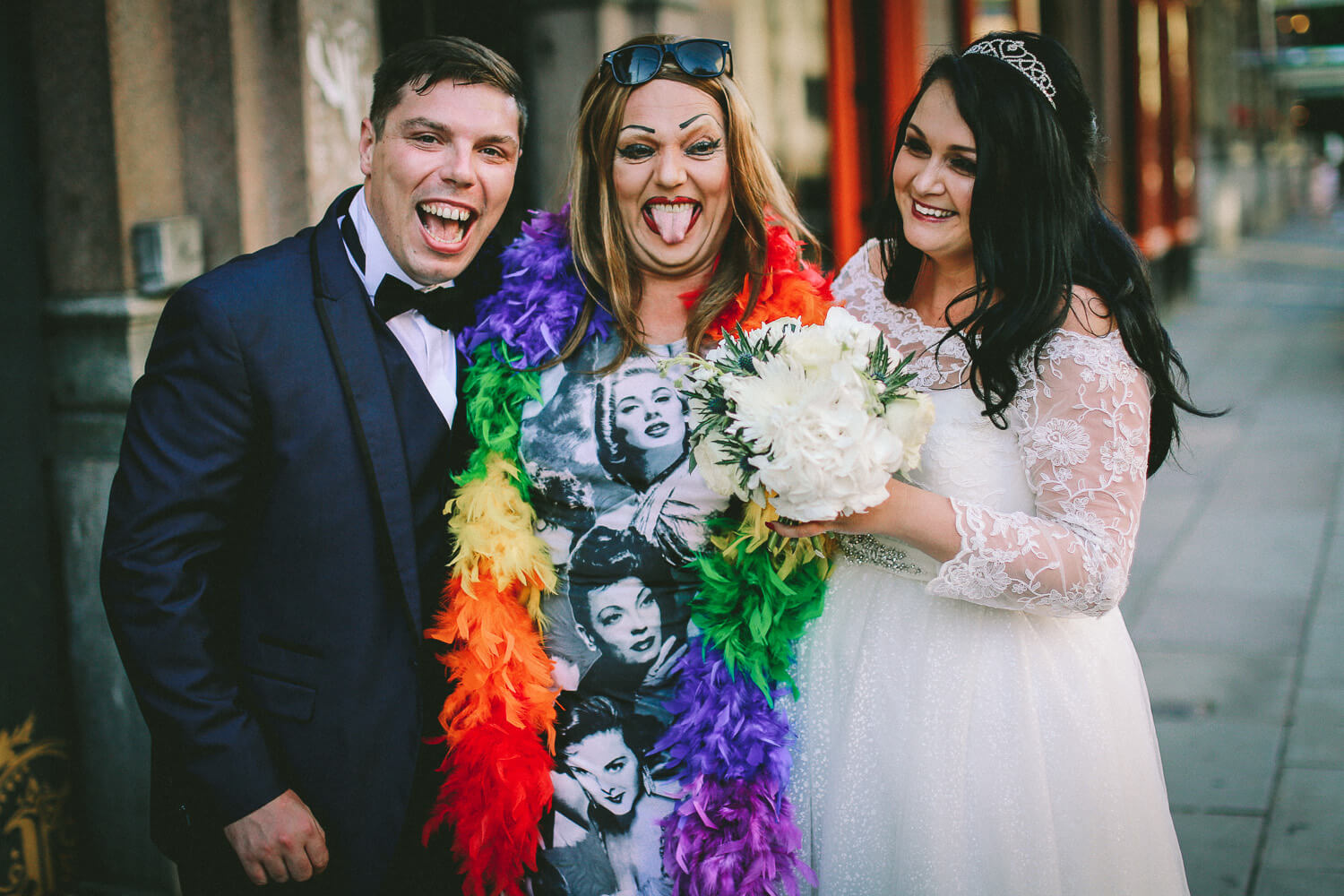 Bride and groom with drag queen outside Lisbon pub Liverpool on wedding day