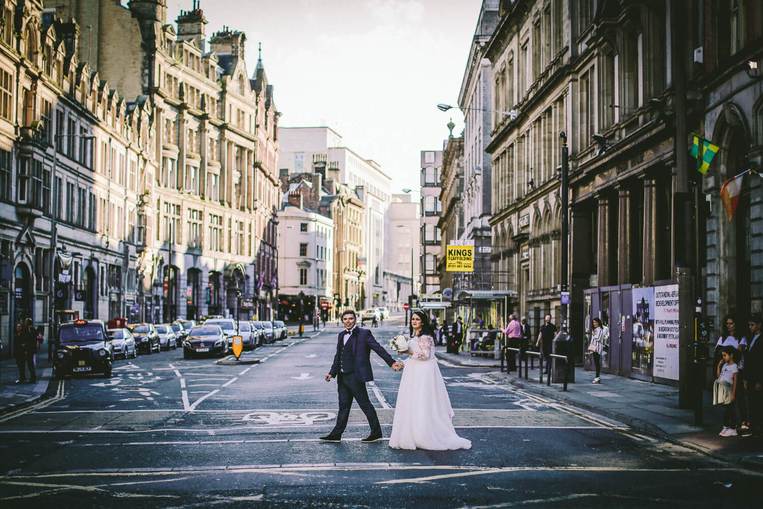 Bride and groom crossing road in Liverpool Sir Thomas Hotel, Liverpool city wedding photographer