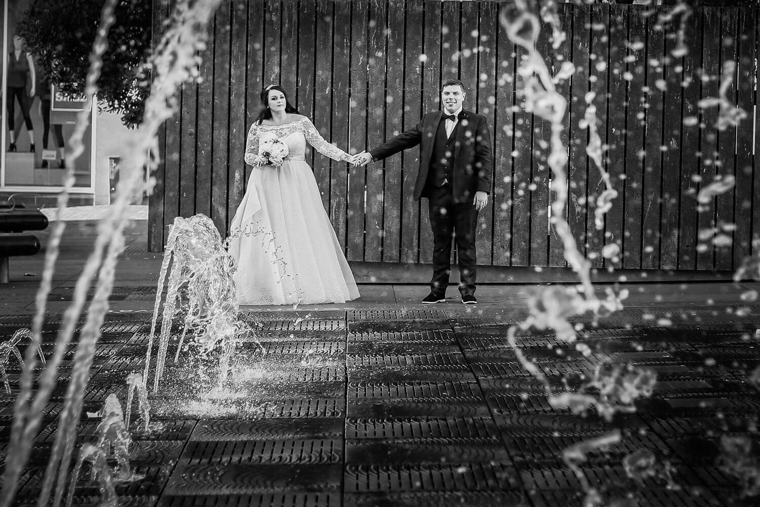 Bride and groom under water fountain queens square liverpool