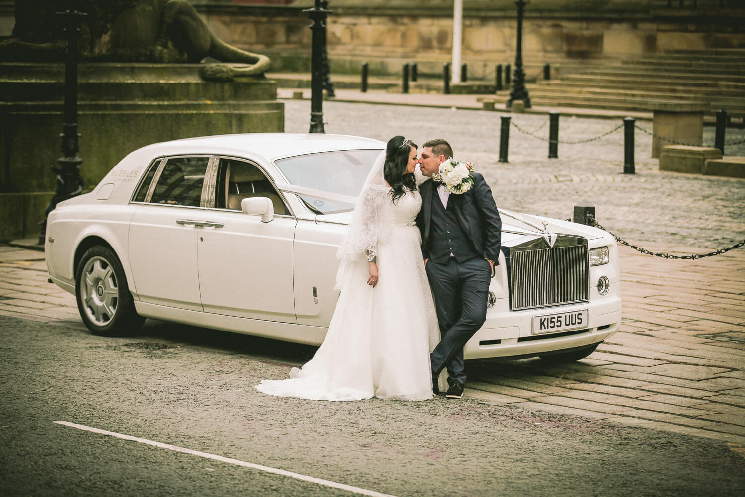 Bride and groom with Rolls Royce at St Georges Hall Liverpool
