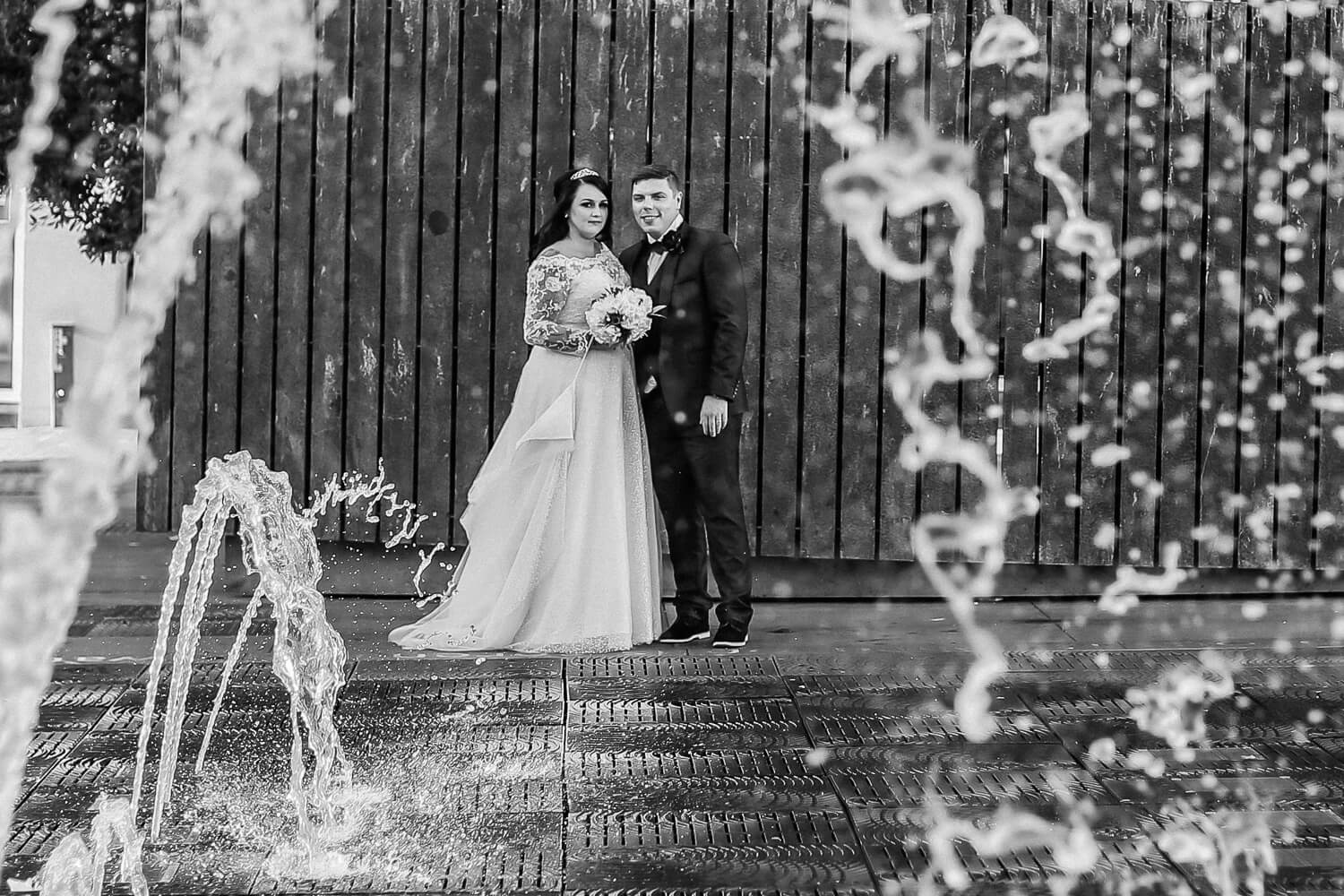 Bride and groom with Queens square water fountain Liverpool