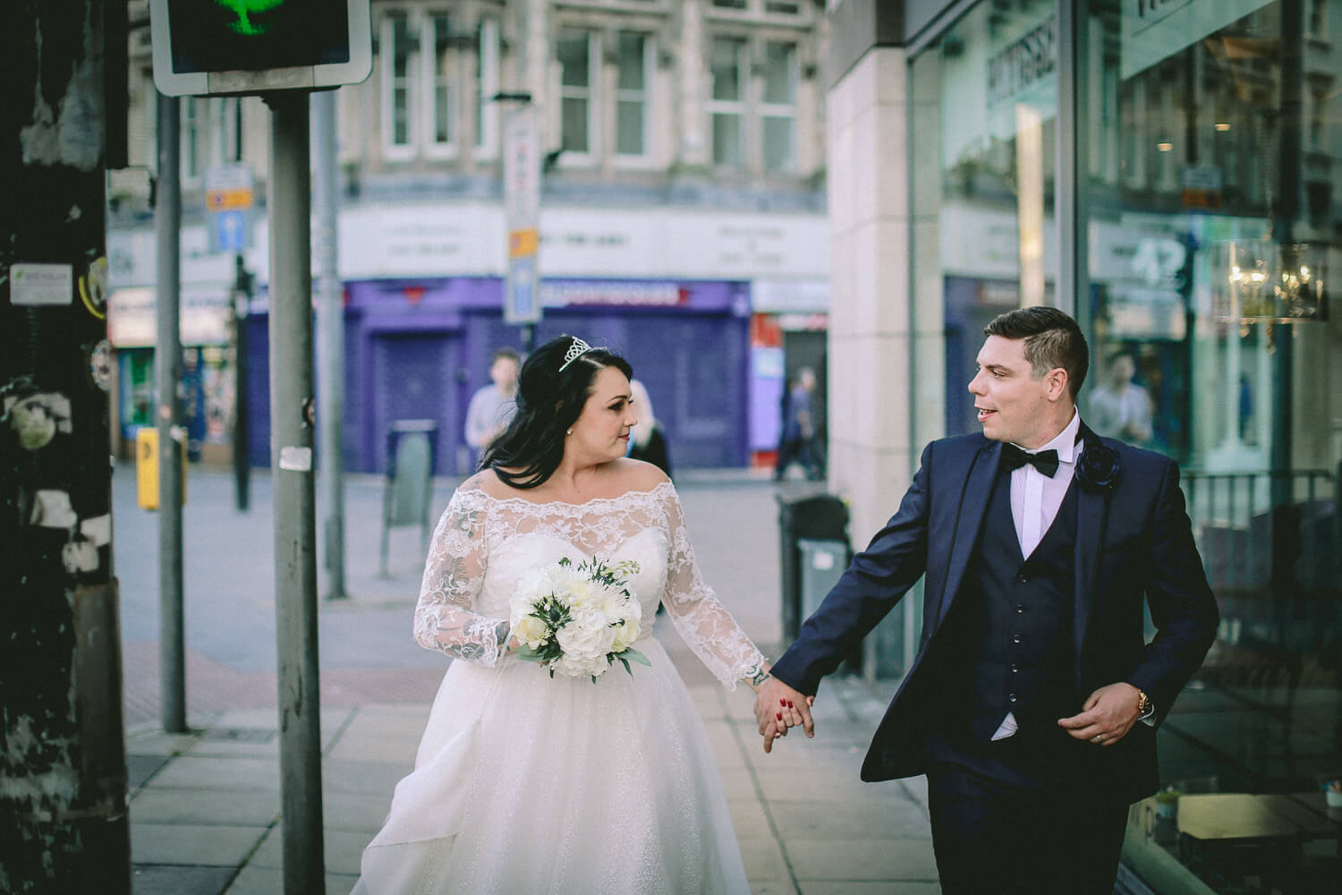 bride and groom walking down liverpool city street Sir Thomas Hotel, Liverpool city wedding photographer