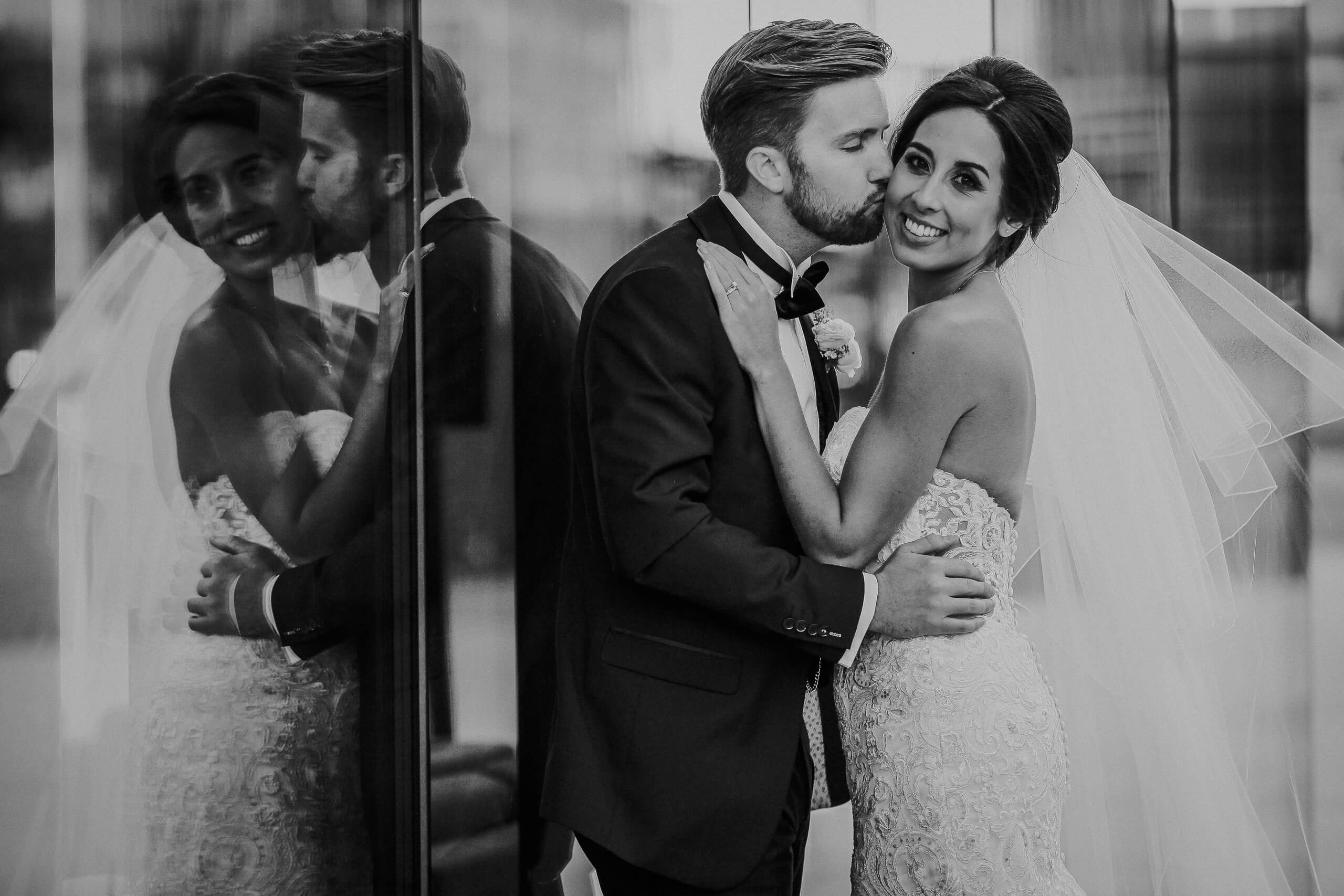 Cool black and white portrait of bride and groom with reflection 30 James Street Liverpool wedding photography