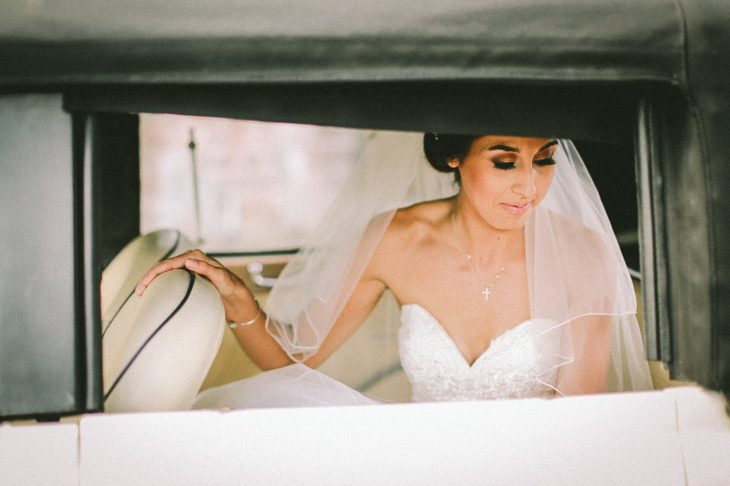 Beautiful picture of bride through window of wedding car 30 James Street Liverpool wedding photography